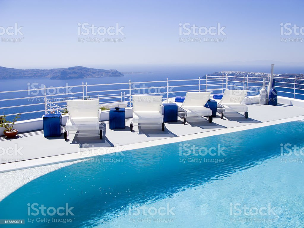 Poolside view of white loungers at a luxury hotel royalty-free stock photo