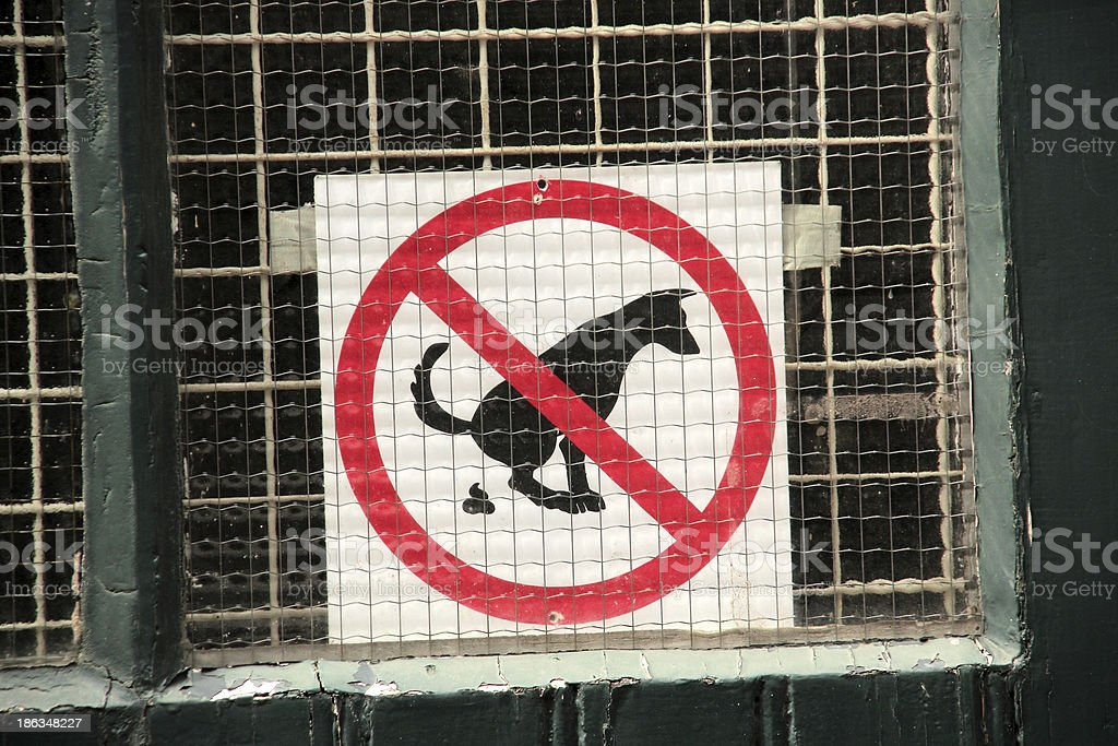 Pooping dog sign royalty-free stock photo