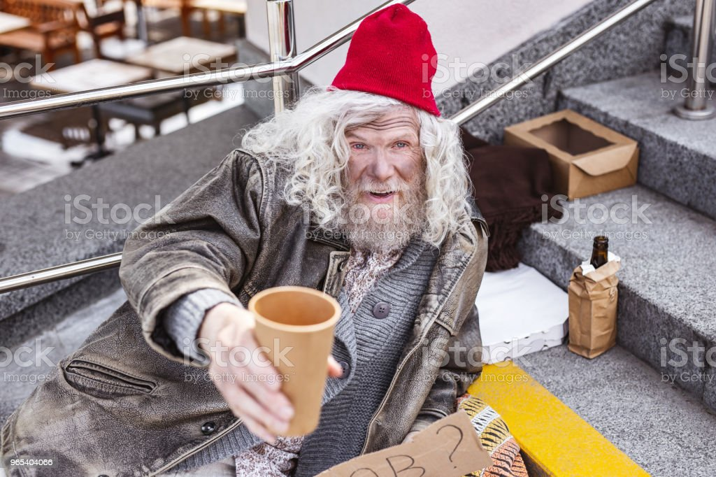 Poor aged man asking for money royalty-free stock photo