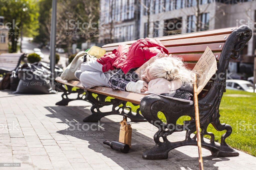 Poor aged man resting zbiór zdjęć royalty-free