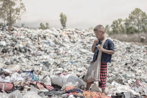 poor children earn money by selling garbage. - poverty stock pictures, royalty-free photos & images