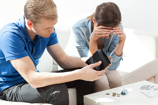 Poor couple with financial problems Poor couple with financial problems not having money single word no stock pictures, royalty-free photos & images