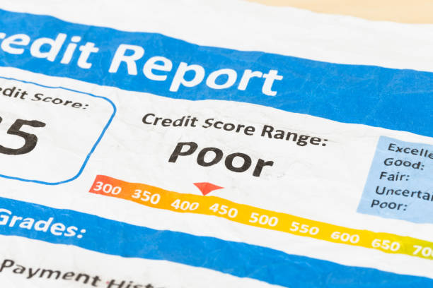 Poor credit score report on wrinkled paper Poor credit score report on wrinkled paper negative emotion stock pictures, royalty-free photos & images