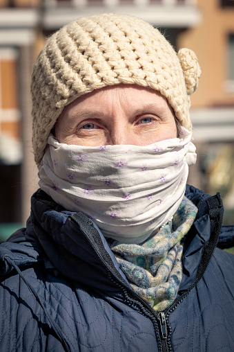 A Poor Elderly Woman Wears A Homemade Mask To Protect Herself From Viruses Stock Photo - Download Image Now