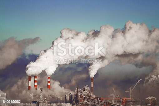 istock Poor environment in the city. Environmental disaster. Harmful emissions into the environment. Smoke and smog. Pollution of the atmosphere by plants. Exhaust gases. 640915990