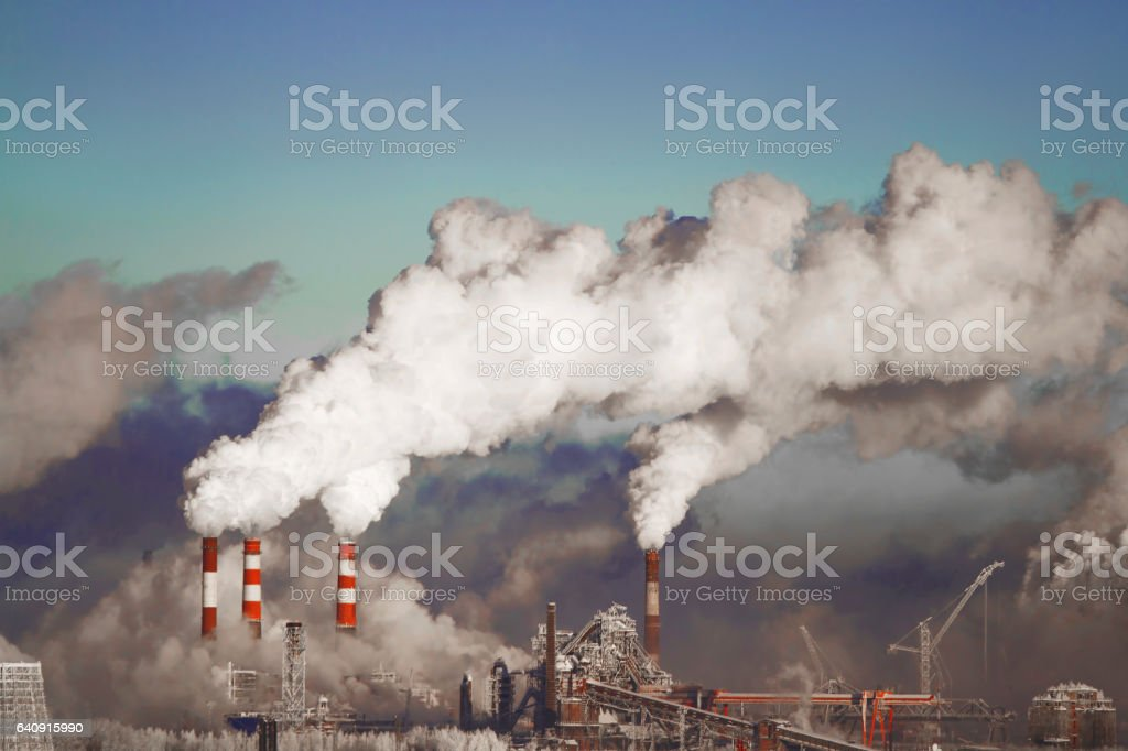 Poor environment in the city. Environmental disaster. Harmful emissions into the environment. Smoke and smog. Pollution of the atmosphere by plants. Exhaust gases. stock photo