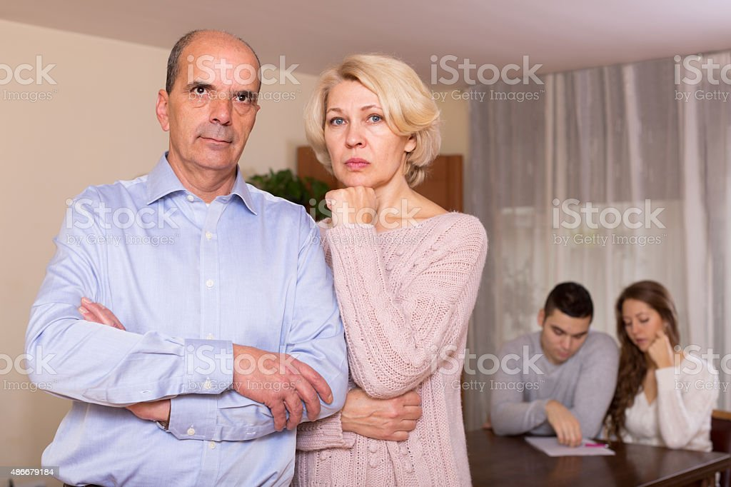 poor family counting money to pay bills at home stock photo