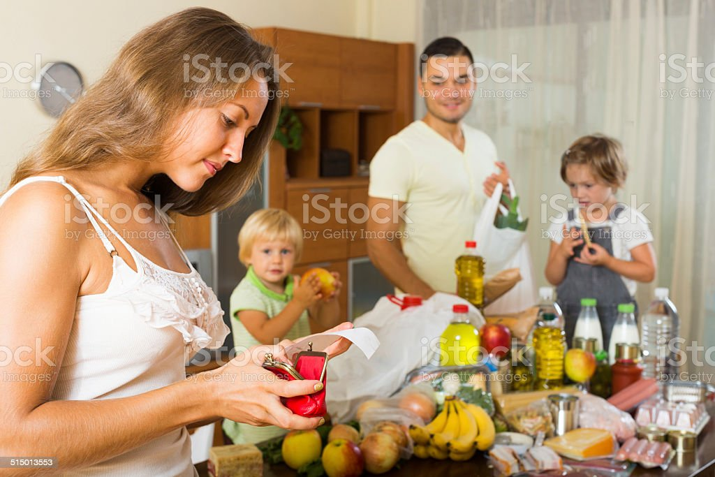 Poor family with bags of food stock photo
