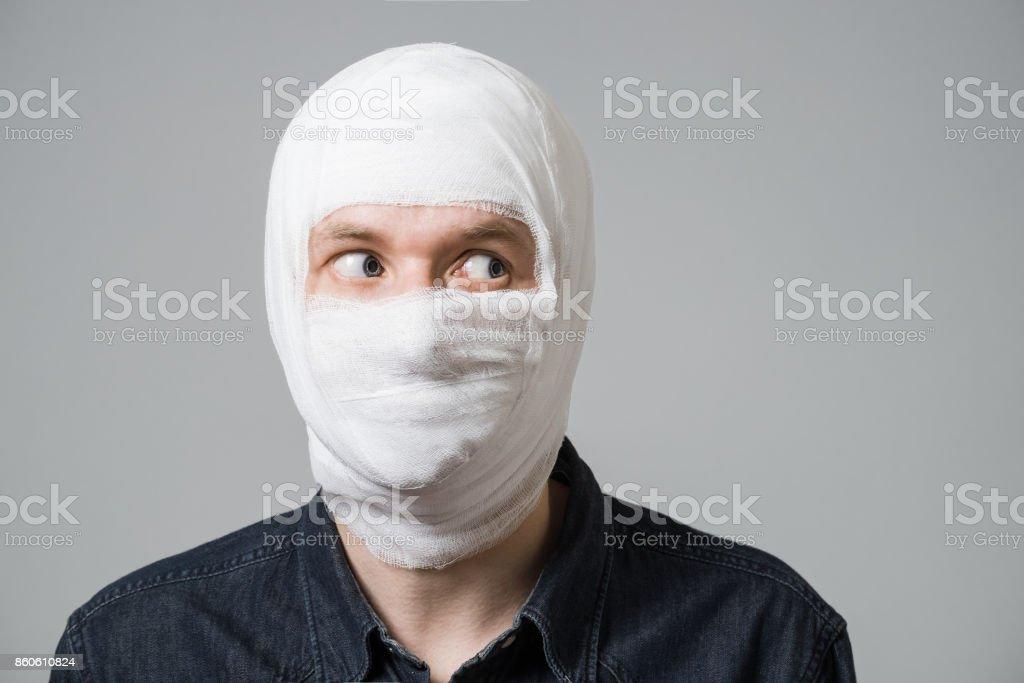 Poor guy with bandage on head stock photo