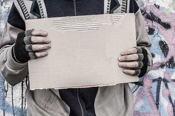 Poor homeless man stock photo