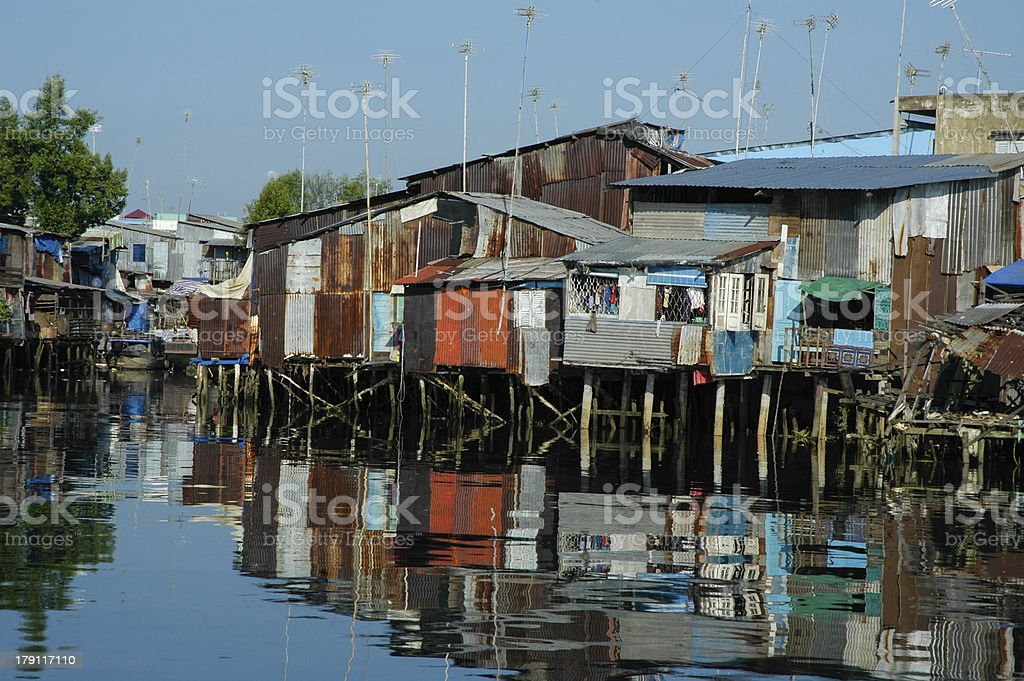Poor housing with canal of sewage royalty-free stock photo
