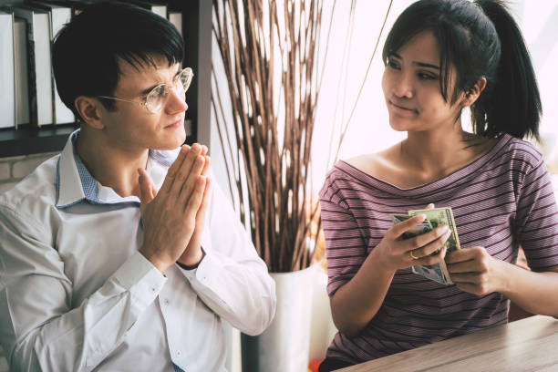 Poor husband begging his wife for money Poor husband begging his wife for money borrowing stock pictures, royalty-free photos & images