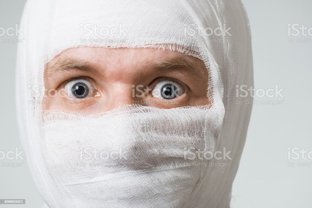 Poor ill man with bandage on his head stock photo