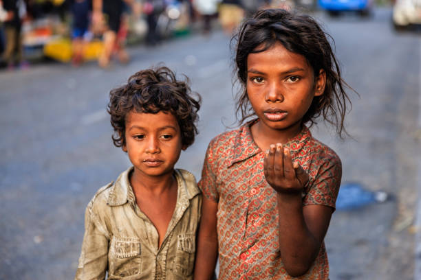 Poor Indian children asking for help stock photo