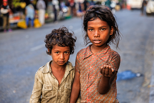 Poor Indian children asking for support. Many Indian children suffer from poverty - more than 50% of India's total population lives below the poverty line, and more than 40% of this population are children.