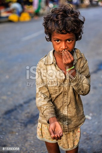Poor Indian girl asking for support. Many Indian children suffer from poverty - more than 50% of India's total population lives below the poverty line, and more than 40% of this population are children.
