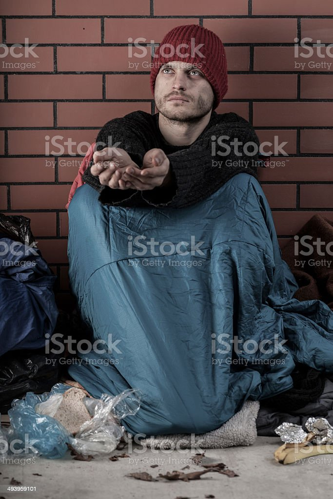 Poor man asking for alms royalty-free stock photo