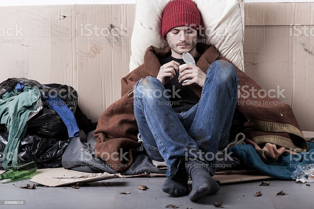 Poor man eating preserve stock photo