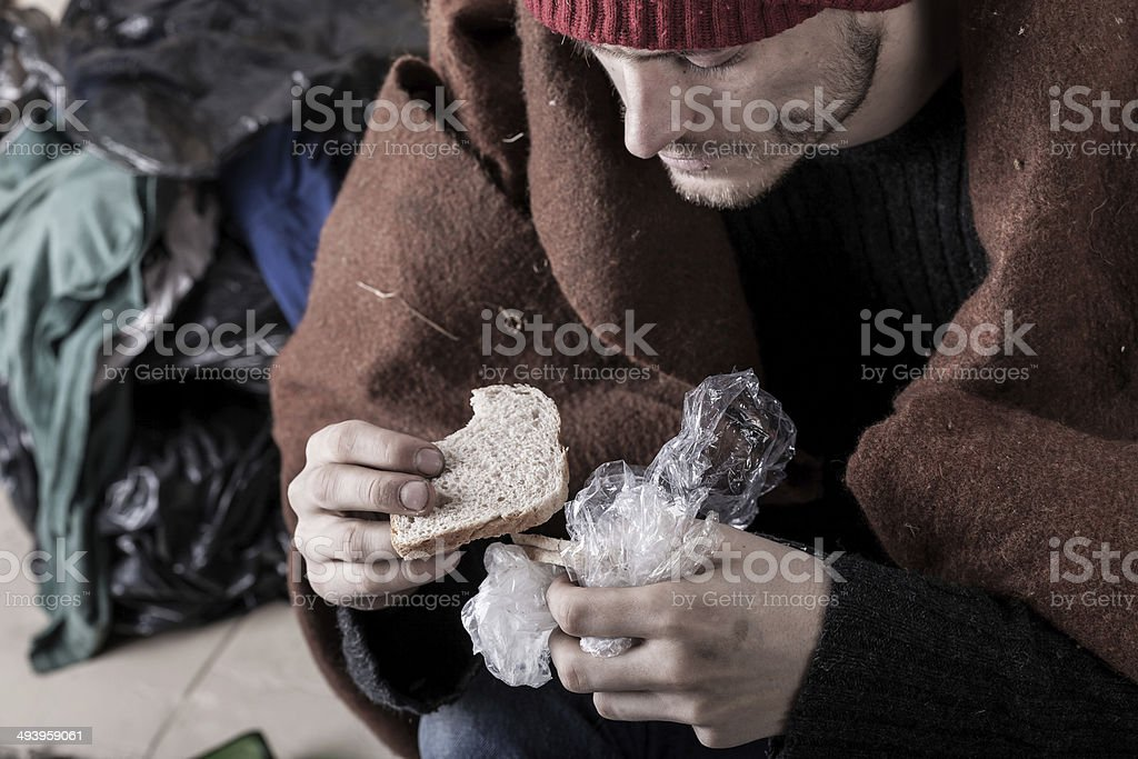 Poor man eating sandwich royalty-free stock photo