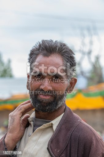 Leh, India - june 21, 2015 : Poor man on the street in mountain village Leh, Ladakh region, north India, close up. Poverty is a major issue in India