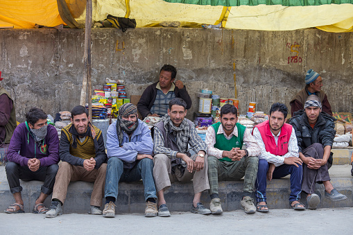 Leh, India - june 21, 2015 : Indian poor men on the street in mountain village Leh, Ladakh region, north India, close up. Poverty is a major issue in India