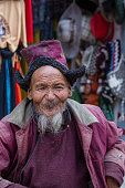 istock Poor old man on the street in mountain village Leh, Ladakh region, north India, close up 1315111091