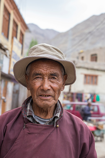 Leh, India - june 21, 2015 : Poor old man on the street in mountain village Leh, Ladakh region, north India, close up. Poverty is a major issue in India