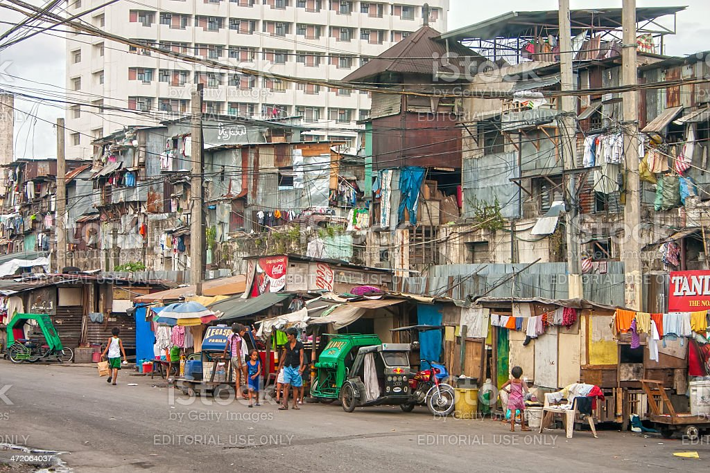 Poor people of Manila living in destroyed buildings stock photo