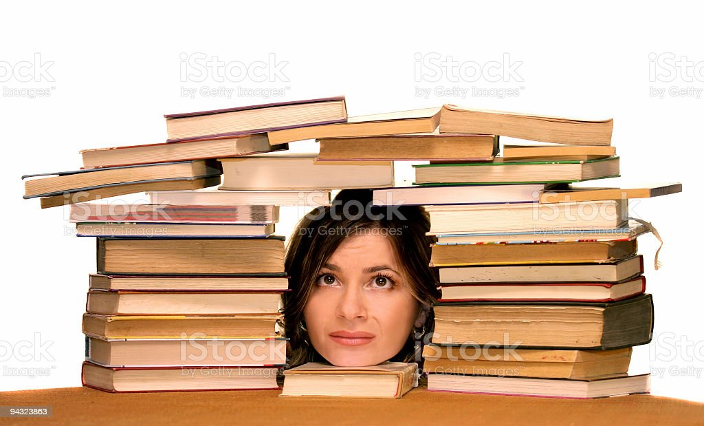 Poor student with many books royalty-free stock photo