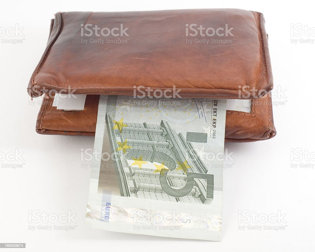Thick wallet with a five euro banknote. Isolated on white.
