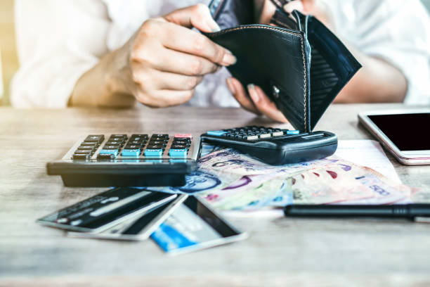 poor woman hand open empty purse looking for money for credit card debt poor woman hand open empty purse looking for money for credit card debt, payday concept empty wallet stock pictures, royalty-free photos & images
