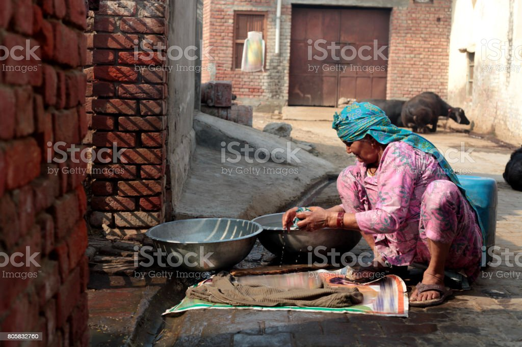 Poor women washing clothes stock photo