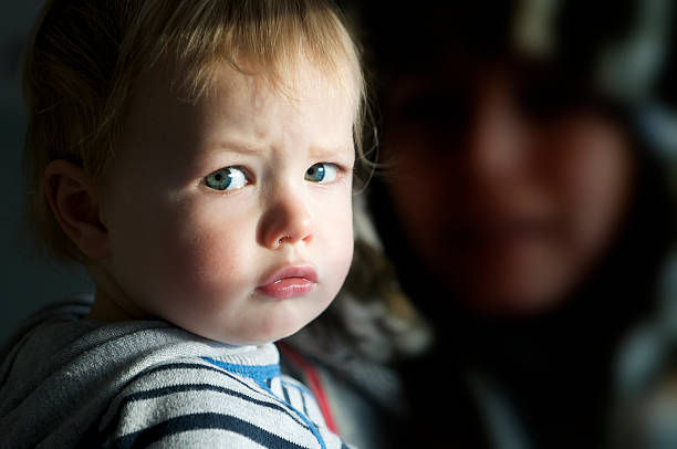 Poorly Boy - Child with cold feeling sorry for himself stock photo