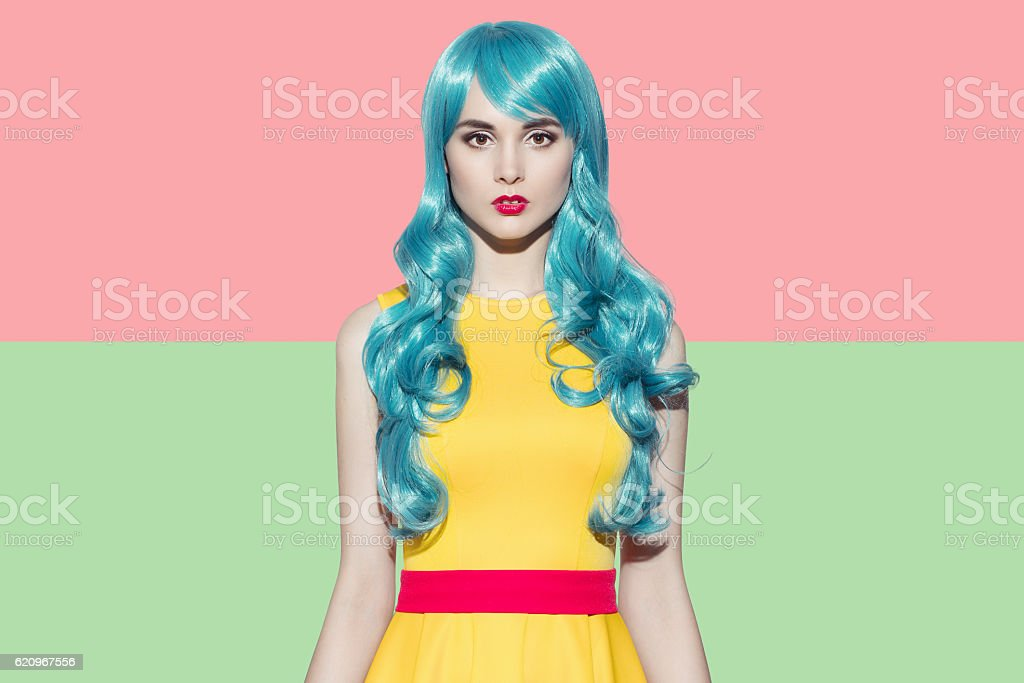 Pop art woman portrait. Blue curly wig and yellow dress stock photo