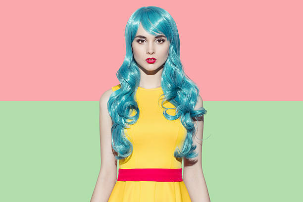 pop art woman portrait. blue curly wig and yellow dress - ausgefallene frisuren stock-fotos und bilder