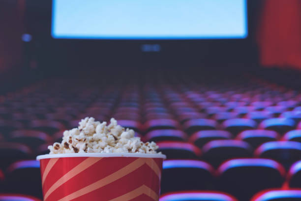 pop corn and on red armchair cinema Movie Theater, Movie, Popcorn, Film Industry, Projection Screen film industry stock pictures, royalty-free photos & images