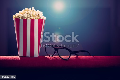 istock pop corn on armchair cinema 506221782
