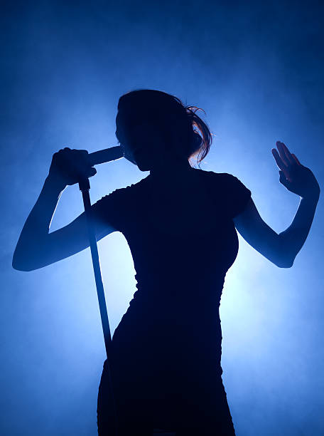 Pop music idol singing on stage stock photo