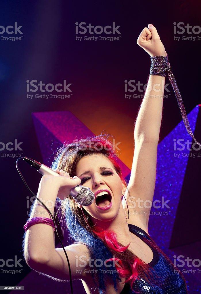 Pop star with hand raised stock photo