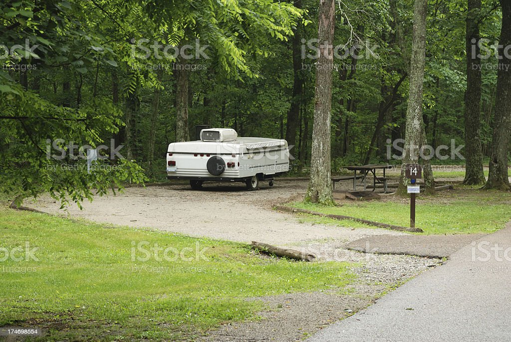 Pop up camper in campsite stock photo