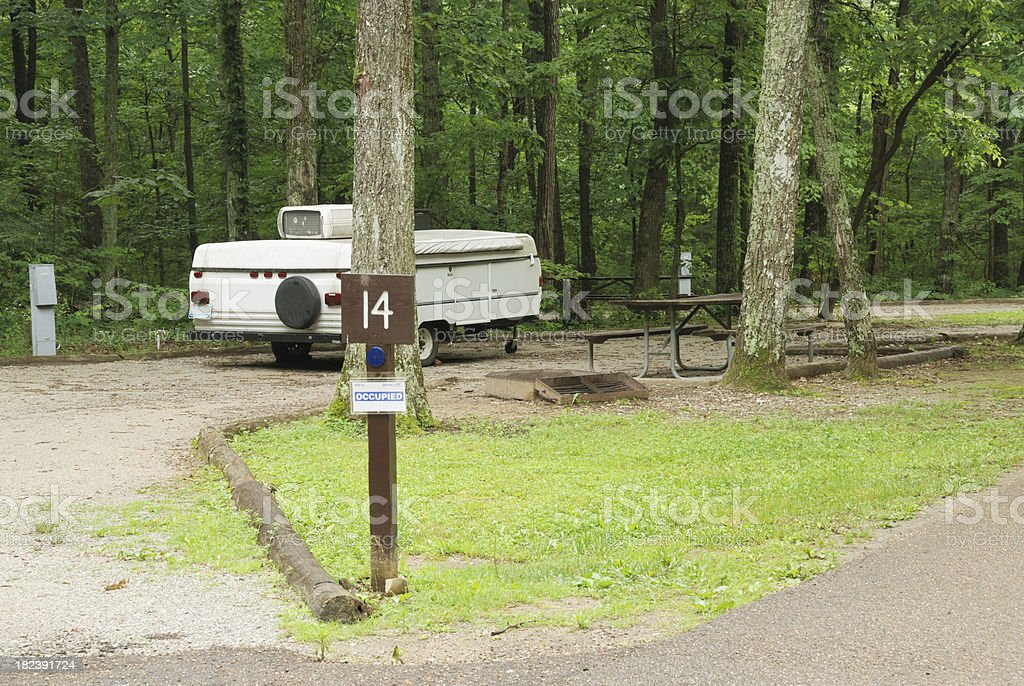 Pop up camper sitting in campsite stock photo