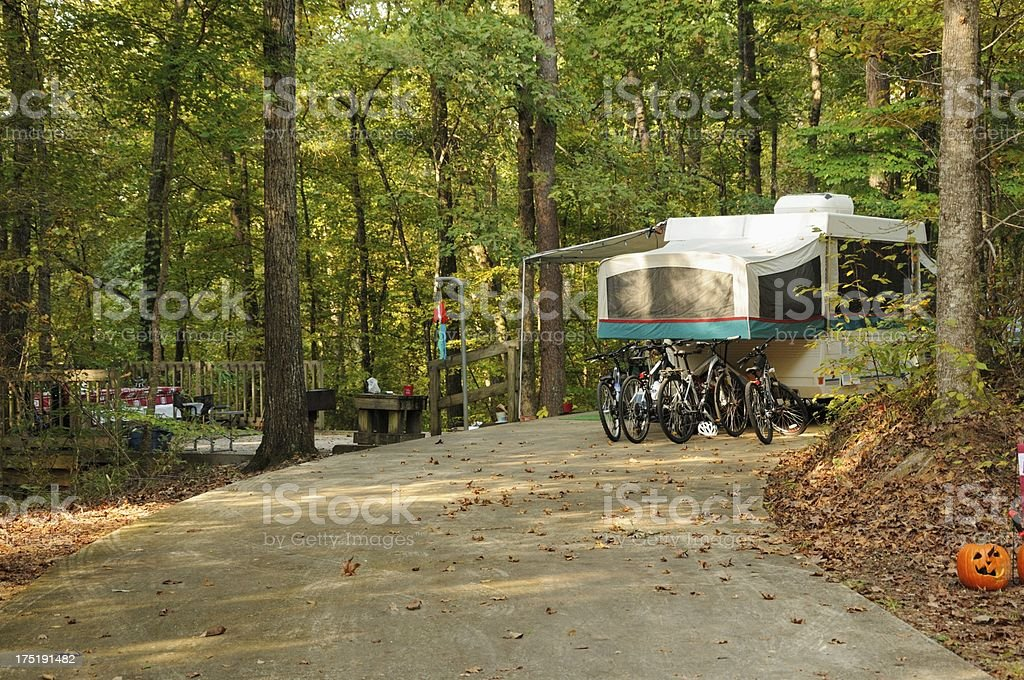 Pop up rv tent trailer in campsite near halloween stock photo