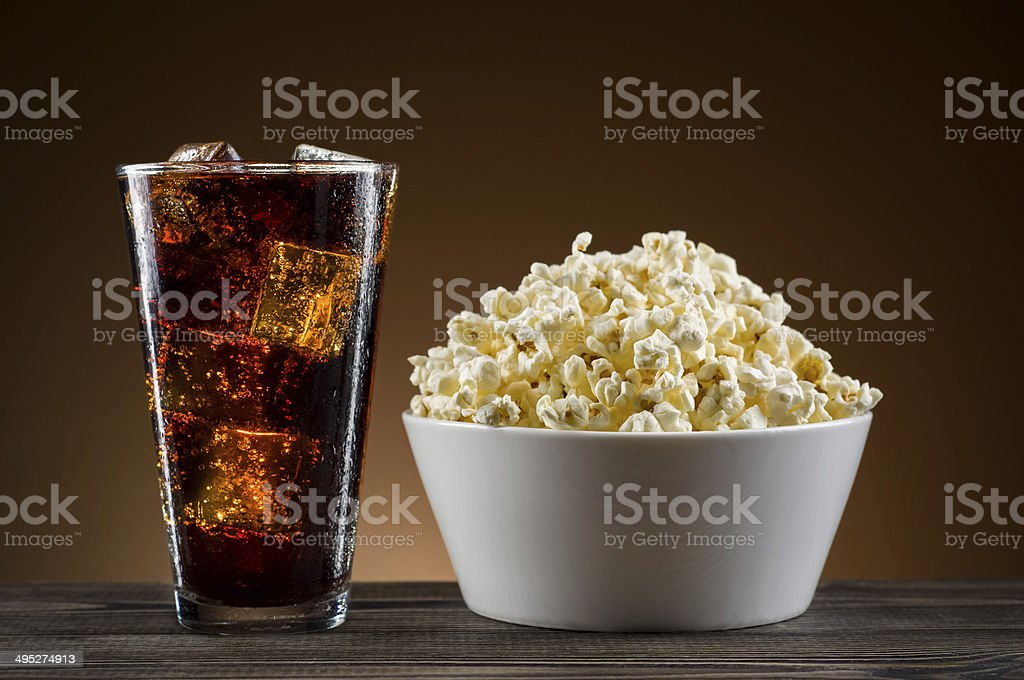 Popcorn and coke on the table stock photo