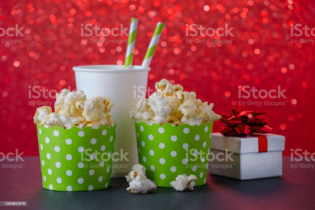 popcorn and drink in paper cup for movie and entertainment, a present, red bokeh background stock photo