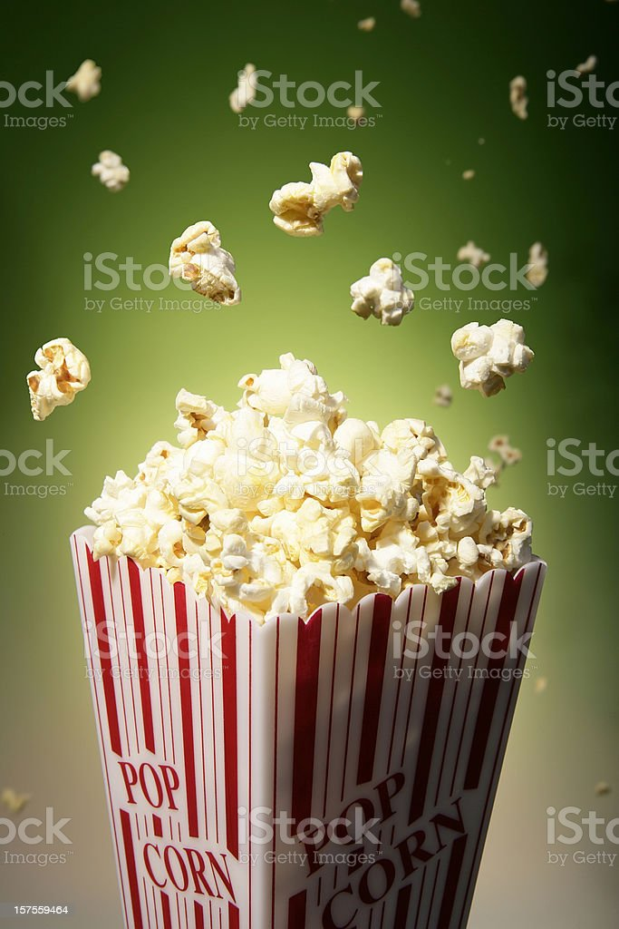 Popcorn and flying popcorn in a box used in movie theaters royalty-free stock photo
