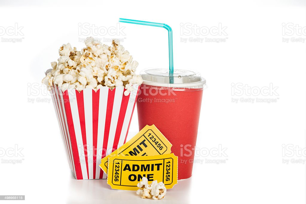 Popcorn and movie ticket on white background for cinema concept stock photo