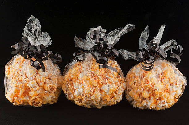 popcorn balls wrapped for Halloween treats Popcorn balls decorated for Halloween treats. popcorn balls halloween stock pictures, royalty-free photos & images