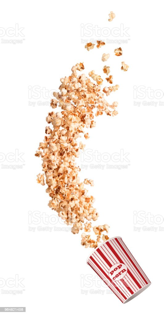 Popcorn beautifully flies out of a paper cup royalty-free stock photo