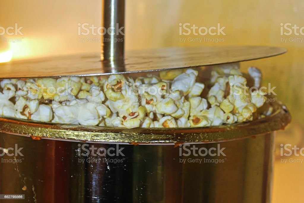 Popcorn being popped in a kettle stock photo