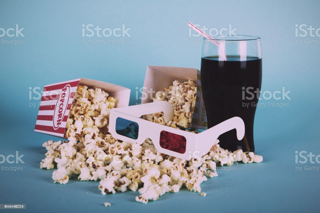 Popcorn bucket against a blue background Vintage Retro Filter. stock photo